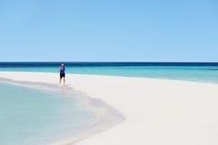 Man Running On Beautiful Beach Stock Photo
