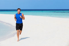 Man Running On Beautiful Beach Royalty Free Stock Image