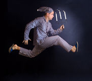 Man running with a candlestick Stock Photos