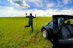 Man Running From Car In Open Field Stock Photo