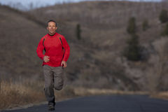 Man Running on Country Road Royalty Free Stock Image