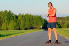Man running on country road Stock Images
