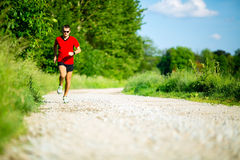 Man running on country road Stock Photos
