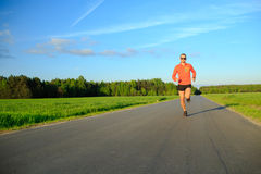 Man running on country road, training inspiration and motivation royalty free stock images