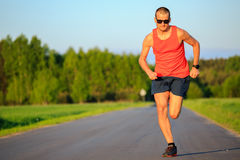 Man running on country road, training inspiration and motivation Royalty Free Stock Photos