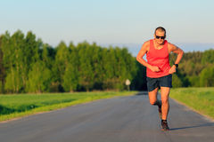 Man running on country road, training inspiration and motivation Royalty Free Stock Photography