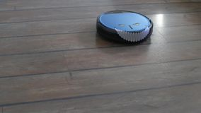 Man running from a crazy robot vacuum cleaner