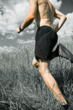 Man running cross country on trail royalty free stock photography
