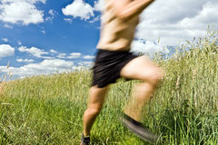 Man running cross country on trail Stock Photo