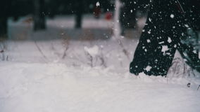 Man Running in the Deep Snow in the Winter Forest at Snowy Day. Slow Motion stock footage