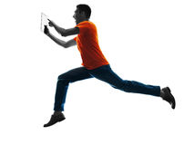 Man running Digital Tablets silhouette isolated Royalty Free Stock Photography
