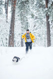 Man running after the dog Royalty Free Stock Photography