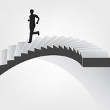 Man running down on spiral staircase Stock Photography