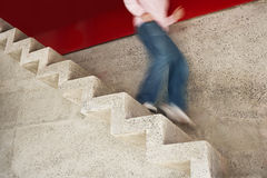 Man Running Down Stairs Royalty Free Stock Photography