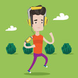Man running with earphones and smartphone. Stock Photo