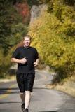 Man running fall colors Stock Photo