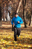 Man running in the forest. Man running in a forest in autumn Royalty Free Stock Photography