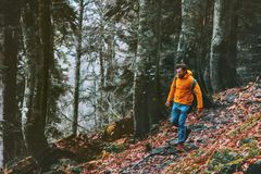 Man running in forest Travel healthy lifestyle royalty free stock photography
