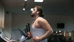 Man running in a gym on treadmill stock video footage