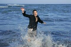 Man running happy on the blue summer beach. Sunny summer Stock Photos