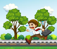 A man running hurriedly with a suitcase Stock Images