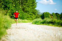 Man running jogging on country road Stock Photography