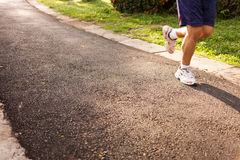 Man running jogging on street Stock Image