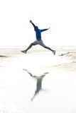 Man running and jumping at the beach Stock Image