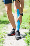 Man running with kinesiotape Royalty Free Stock Image