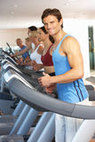 Man On Running Machine Stock Photo