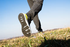 Man running in nature, shoes close up. Bottom view stock photos