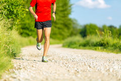 Man Running On Country Road Stock Photo