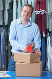 Man Running Online Clothes Store. Man Running Online Clothing Business From warehouse Stock Image