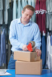 Man Running Online Clothing Store. Man Running Online Clothing Business From warehouse Royalty Free Stock Photography