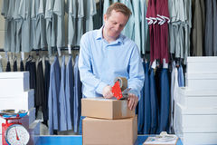 Man Running Online Clothing Store. From Warehouse Stock Image