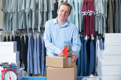 Man Running Online Clothing Store. From Warehouse Royalty Free Stock Images