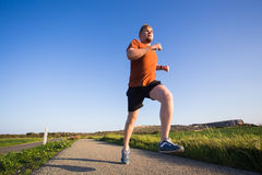 Man running outdoor sprinting for success. Male fitness runner sport athlete in sprint at great speed in beautiful Stock Images