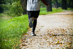 Man running outdoors in park Stock Images