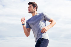 Man running outdoors royalty free stock images