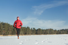 Man running outdoors in winter snowy day Royalty Free Stock Photo