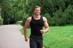 Man running in park Stock Image