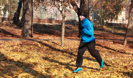 Man running in a park. In autumn Royalty Free Stock Images