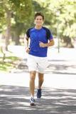 Man Running Through Park Stock Images