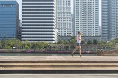The man running in the park. Bangkok,Thailand - January 13, 2018: The man running in the park at the morning Royalty Free Stock Photography