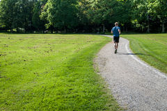 Man running in a park royalty free stock images