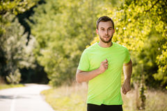 Man running in park Stock Photos