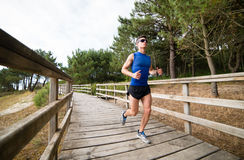 Man running in a promenade outdoors Stock Photography