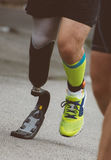 Man running with prosthetic leg. stock photo