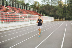 Man running on a racing track Royalty Free Stock Photography