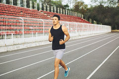 Man running on a racing track Royalty Free Stock Images